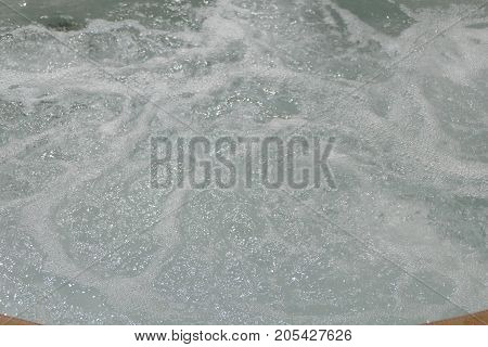 Texture Of A Whirling Water In A Pool
