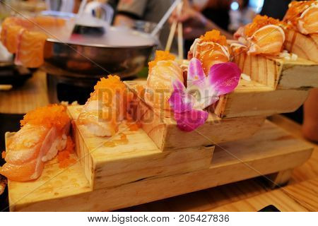 sashimi sushi set with chopsticks and soy - sushi roll with salmon and sushi roll with smoked eel selective focus.