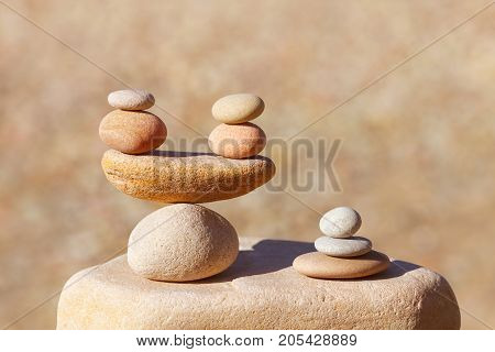 Symbolic scales of stones on blurred background. Concept of harmony and balance. Pros and cons concept. Soft focus selective focus