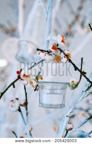 white and green tree branch with blossoming buds flowering tree branches with white flowers and a garland of candlesticks branch with blossoms decorated background wedding decor vertical
