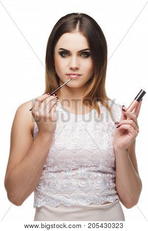 Beautiful Woman With A Brush For Makeup Near The Face
