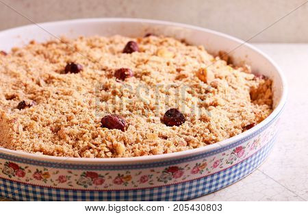 Fruit crumble cake with hazelnut oat and whole wheat topping