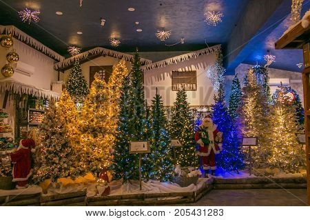 VETRALLA, ITALY - SEPTEMBER 23, 2017: Interior of the reign of Santa Claus shop with christas trees, lights and decorations