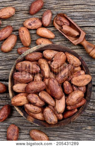 Cacao beans in a bowl on table close-up