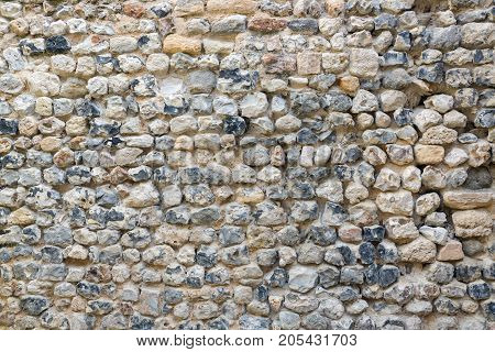 Background of old brickwork with stones of different color