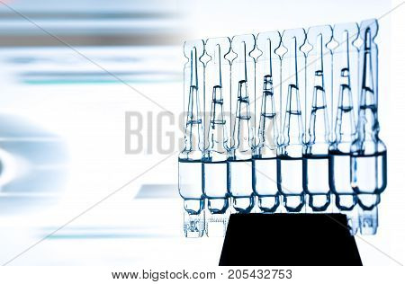 Group of ampoules with a transparent medicine in a medical laboratory