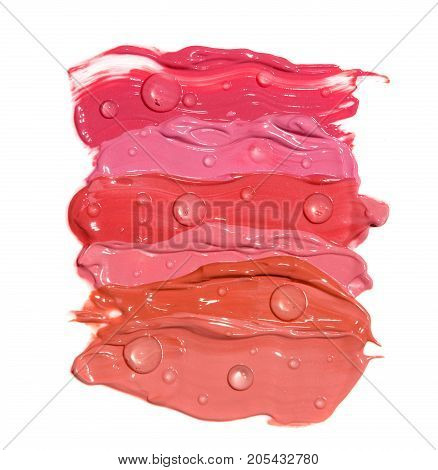 Smudged of different shades lipstick with beads of water isolated on white background
