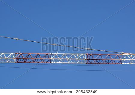 part of arm machinery construction crane with blue sky background .
