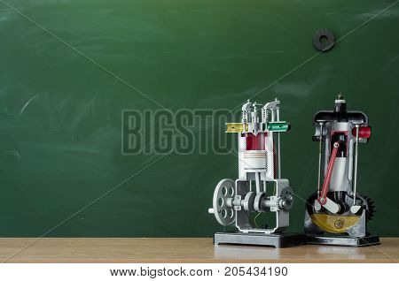 Teacher student or engineer mechanics desk table. Education background. Education concept. Education models of internal combustion engine on the table.