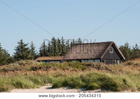 Danish holiday home with thatched roof near the beach