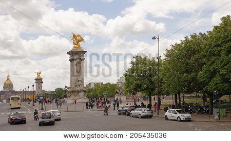 Paris; France- May 01; 2017: The bridge of Alexander III. On the bridge is moving transport walking people
