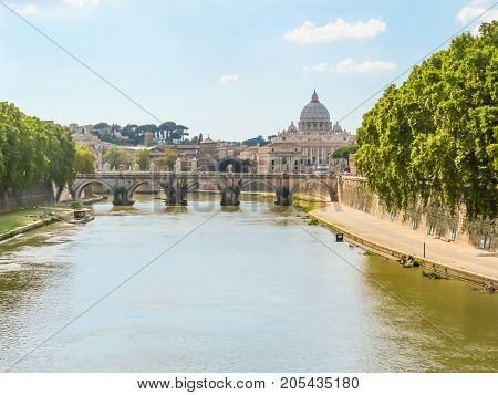 Rome cityscape. Tiber River, St. Angelo Bridge and St Peter's Basilica in Vatican City