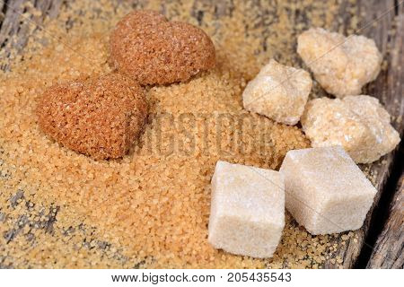 Different kinds of brown sugar on wooden table