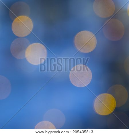 Christmas Background. Golden Holiday Abstract Glitter Defocused Background With Blinking Stars. Blur