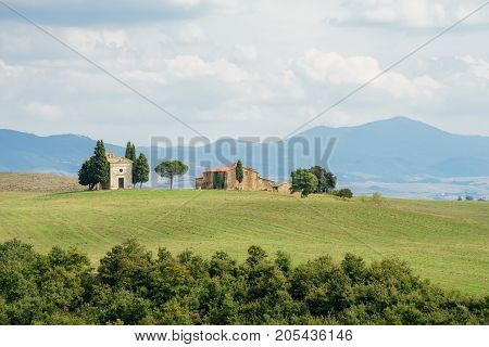Medieval Chapel of the Madonna di Vitaleta in Val d'Orcia, Tuscany, Italy. Monte Amiata visible in the background.