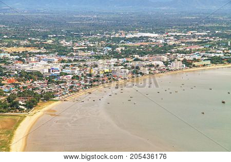 City and beach at Prachuap Bay. a bay in the west side of the Gulf of Siam or Gulf of Thailand.