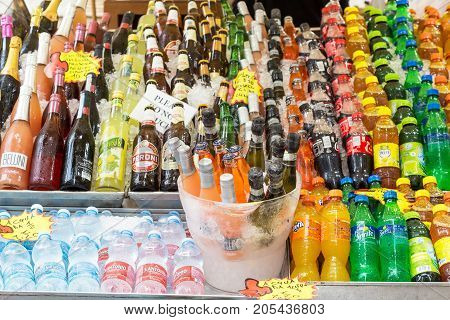 VENICE, ITALY - SEPTEMBER, 2017: Many fresh drinks cola, beer, juices, limonade on the street Outdoor summer bar