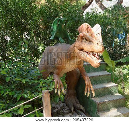 Kemer;Turkey- September 06; 2017: Baby mechanical swing-dinosaurs. In the Dinopark