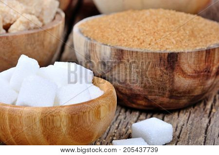 Bowls with different kinds of sugar on table