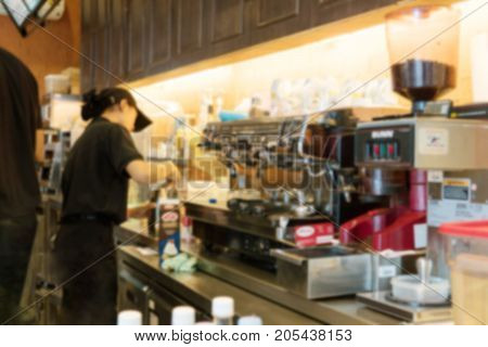 Blurry Background of professional Barista in the coffee shop with coffee machine and a fully equipped.