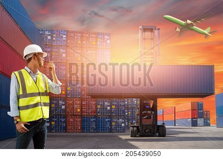 Foreman control loading Containers box from Cargo freight ship for import and export, Freight shipping containers at the docks