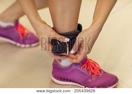 Woman Execute Exercise With Exercise-machine In The Gym. Closeup Photo Of Sport Sneakers