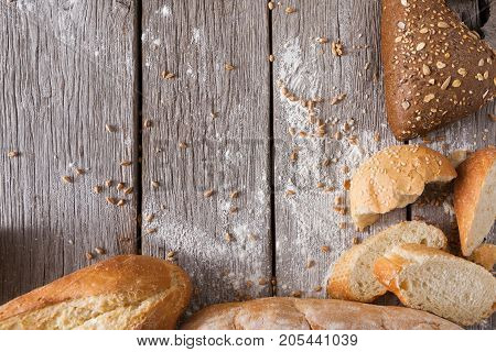 Bread background on rustic wood. Bakery concept with copy space