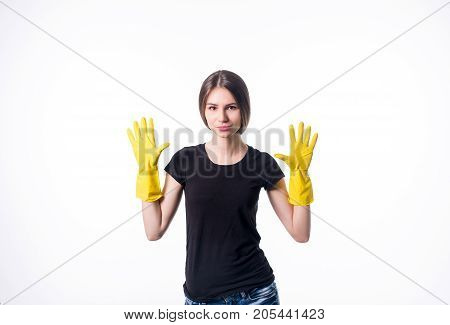 Picture of beautiful housewife with yellow protective gloves. Isolated on white.