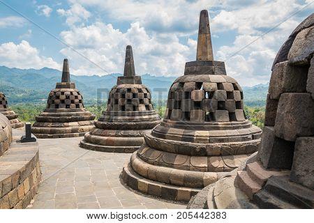 Borobudur buddhist temple with sunny and cloudy day in Yogyakarta, Java, Indonesia.
