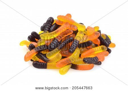 pile of halloween gummy worms on white