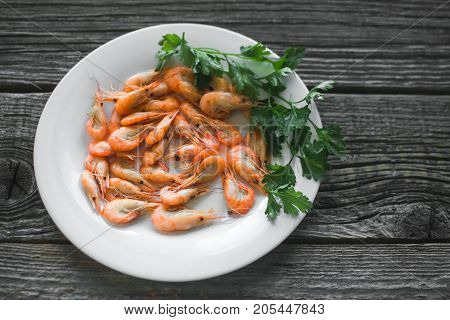On A Wooden Table Beautifully Arranged Shrimp