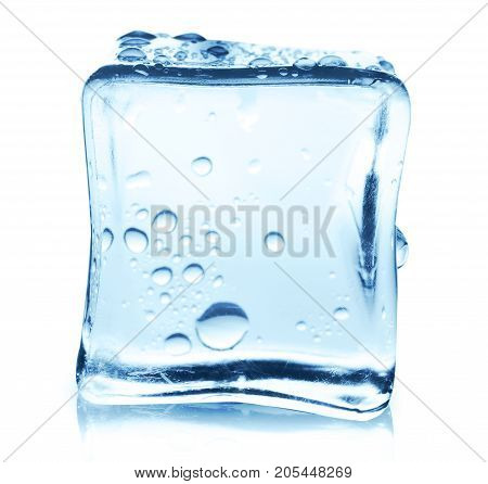 Transparent ice cube with reflection on white isolated background. Closeup of cold crystal block cutout