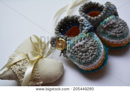 knitted children's Slippers and lace heart, mother's love