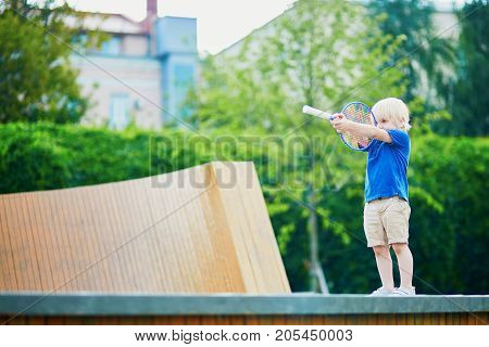 Little Boy Playing Badminton With Mom On The Playground