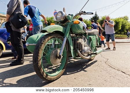 Old Restored Motorcycle Izh Green At The Exhibition Of Vintage Cars