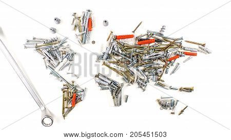 map of the world made of screws fasteners and other mechanical tools with screwdriver on white background worldwide construction industry concept