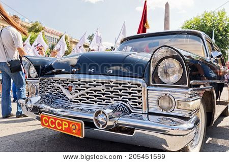 Estored And Painted In Shiny Metallic Black Chaika Gaz-13 At The Exhibition Of Vintage Cars