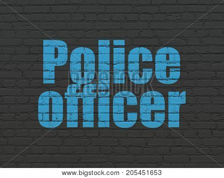 Law concept: Painted blue text Police Officer on Black Brick wall background