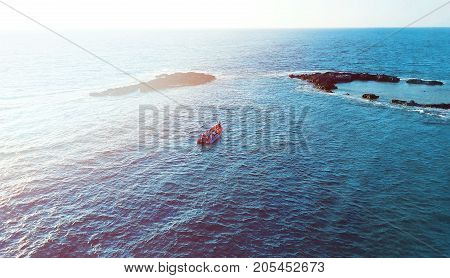 Aerial photo above rock outcrop and reef in crystal clear warm water. Coast of Mediterranean sea in Israel