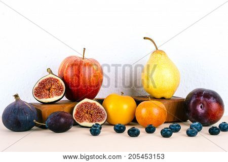 Organic autumn seasonal fruits. Diet and healthy food concept.