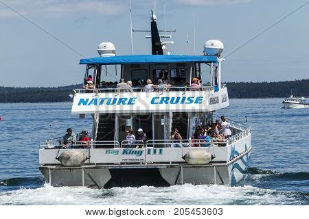 Bar Harbor Maine USA - 28 July 2017: The Bay King III catamaran of the Bar Harbor Whale Watch Company leaving the docks with passengers on a nature cruise tour.