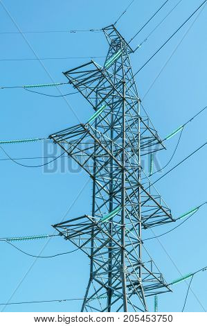 The design of the support high voltage power lines with glass insulators. The four-level transmission lines with high voltage wires.