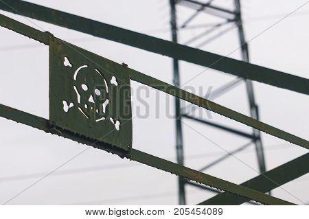 Danger sign on a metal electric trellis