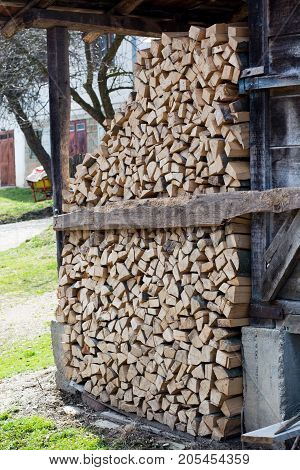 Stack of firewood. big pile of firewood for the furnace in the village