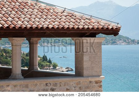 Arbor of Mediterranean architecture overlooking the Bay of Kotor Montenegro