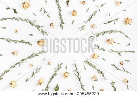 Flowers composition. Frame made of rose flowers and eucalyptus branches on white background. Flat lay top view copy space