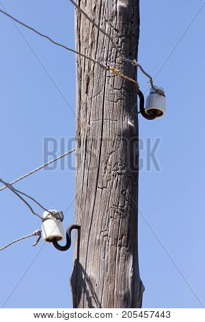 wooden pole with electricity . In the park in nature