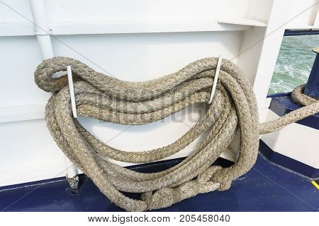 Folded mooring ropes for attaching the ship to the berth mooring barrels and bollards or to another vessel