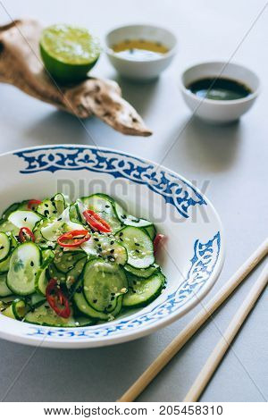 Thai cucumber salad with sesame and chili dressing for salad Asian cuisine