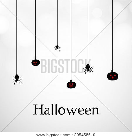 illustration of hanging pumpkins and spiders with Halloween text on the occasion of Halloween